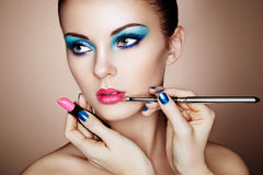Makeup artist applies lipstick Stock Images