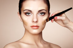 Makeup artist applies skintone Stock Image