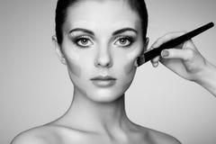 Makeup artist applies skintone Royalty Free Stock Photos