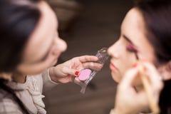 Makeup artist apply makeup Royalty Free Stock Photos