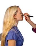 Makeup artist apply makeup to a model Stock Photo