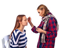 Makeup artist apply makeup to a model Stock Photography