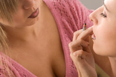 Makeup artist applying cosmetics Royalty Free Stock Image