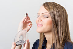 Makeup artist applying eye shadow to beautiful model Royalty Free Stock Photo