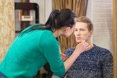 Makeup artist applying foundation. Royalty Free Stock Photo