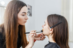 Makeup artist applying foundation Stock Image
