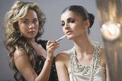 Makeup Artist Applying Foundation To Fashion Model Stock Photography