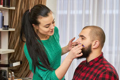 Makeup artist is applying foundation. Stock Photography