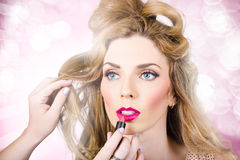 Makeup artist applying lipstick on beauty model Royalty Free Stock Image