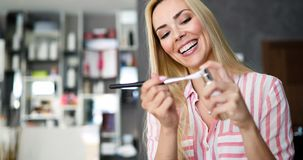 Makeup artist applying liquid tonal foundation on the face of the woman in make up room. Makeup artist applying liquid tonal foundation on the face of the woman Royalty Free Stock Images