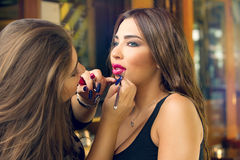 Makeup artist applying make up on beautiful model Stock Photography