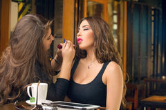 Makeup artist applying make up on beautiful model Stock Images