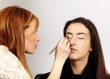 Makeup artist applying makeup Stock Photos
