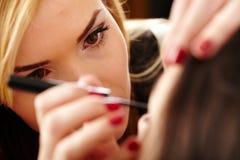 Makeup artist applying makeup Stock Image