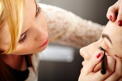 Makeup artist applying makeup Royalty Free Stock Photography
