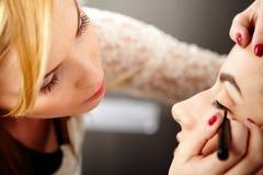Makeup artist applying makeup Royalty Free Stock Photography