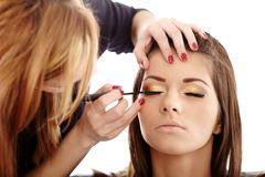 Makeup artist applying makeup Royalty Free Stock Photo
