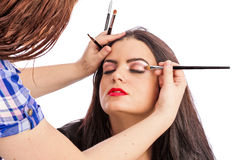 Makeup artist applying makeup Stock Photo