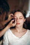 Makeup Artist Applying Makeup Royalty Free Stock Images