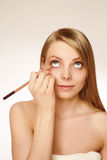 Makeup artist applying mascara Stock Photos
