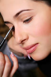 Makeup artist applying mascara on the eyelashes Royalty Free Stock Photo