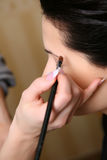 Makeup artist applying mascara on the eyelashes Royalty Free Stock Images