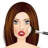 Makeup artist applying powder brush to woman Royalty Free Stock Images