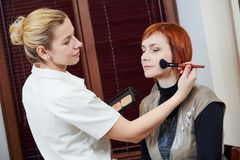 Makeup artist applying tonal cream Stock Image