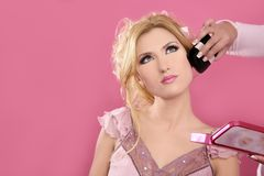 Makeup artist in beautiful blonde face royalty free stock images