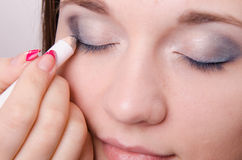 Makeup artist bright tints eyelids model Stock Image