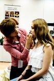 Makeup artist bring girl make-up Royalty Free Stock Photography