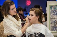 Makeup artist bring make-up girl Royalty Free Stock Photo