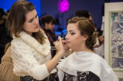 Makeup artist bring make-up girl. City of Orenburg, Southern Ural, Russia Royalty Free Stock Images