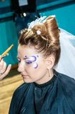 Makeup artist bring make-up girl. Stock Photography