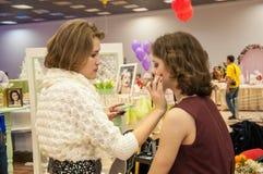 Makeup artist bring makeup girl.- Royalty Free Stock Photos