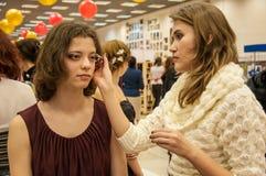 Makeup artist bring makeup girl.- Royalty Free Stock Image