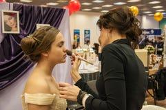 Makeup artist bring makeup girl.- Royalty Free Stock Photography