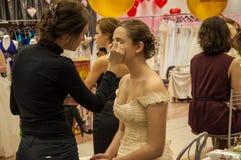 Makeup artist bring makeup girl.- Stock Photo