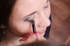 Makeup artist brush eyelash tints model Royalty Free Stock Image