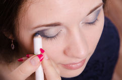 Makeup artist brush eyelash tints model Stock Photography