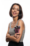 Makeup artist with brushes in hand. On a white background Stock Photos