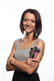 Makeup artist with brushes in hand. On a white background Stock Image
