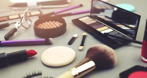Makeup artist cosmetics set on gray table stock video