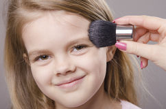 Makeup artist deals powder on face of girl Royalty Free Stock Photos