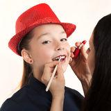 The makeup artist does a make-up to the girl Royalty Free Stock Images