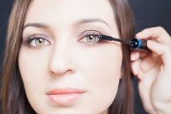 Makeup artist doing make up for beautiful arabian woman Stock Photos