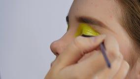 Makeup artist doing professional comic pop art make-up. Funny cartoon or comic strip make-up. Makeup artist doing professional comic pop art make-up. Funny stock footage