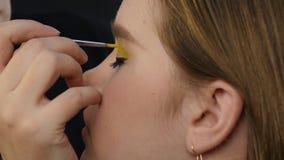 Makeup artist doing professional comic pop art make-up. Funny cartoon or comic strip make-up. Makeup artist doing professional comic pop art make-up. Funny stock video