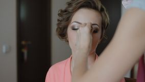 Makeup artist doing visage stock video