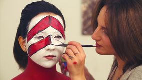 Line Drawing Of Child S Face : Makeup artist drawing the line on model`s face stock footage
